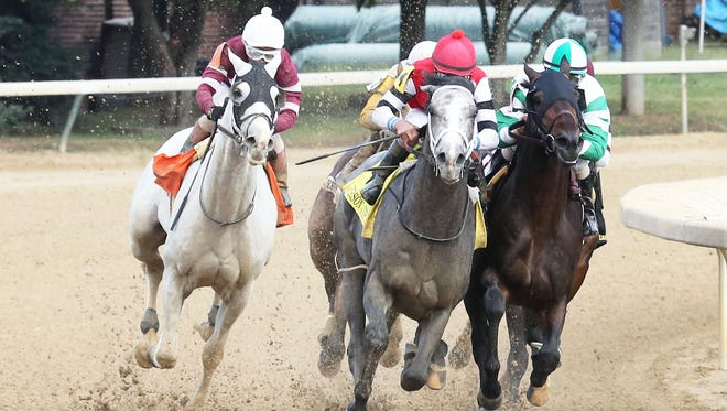 One Mean Man, under jockey Robby Albarado, takes the lead out of the turn in the Oct. 1 $100,000 Jefferson Cup at Churchill Downs. One Mean Man won by 1 1/2 lengths.