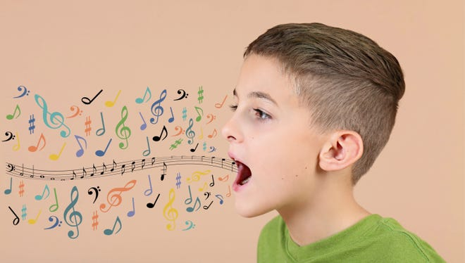 Young Boy with colorful music notes coming out of mouth