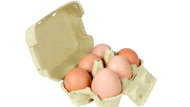 egg box with six brown eggs isolated