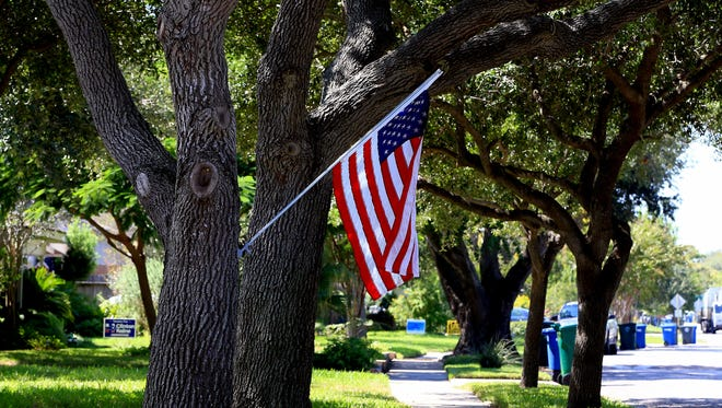 GABE HERNANDEZ/CALLER-TIMESAn American flag is displayed outside of a home in an area with high voting turnout on Wednesday, Sept. 28, 2016, in Corpus Christi.