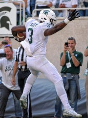 Michigan State running back LJ Scott (3) runs the ball