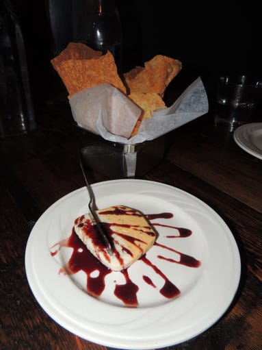 """Forget bread and butter – at Park each table gets """"house cheese and crackers,"""" with a spread made of cheddar and herbs topped with port wine reduction."""