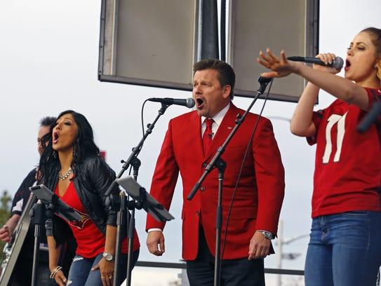 Arizona Cardinals President Michael Bidwill sings on