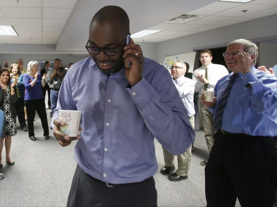 Detroit Free Press columnist Stephen Henderson takes one of many phone calls after learning that he won the  2014 Pulitzer Prize for commentary in Detroit on Monday, April 14, 2014. Press
