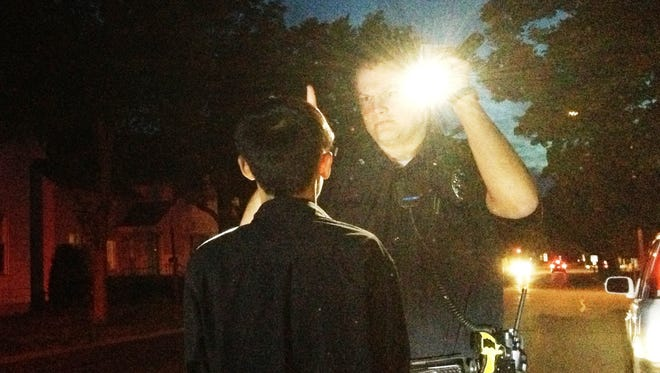 Wausau Police Officer Brent Olson administers field sobriety tests to a man suspected of drunken driving.