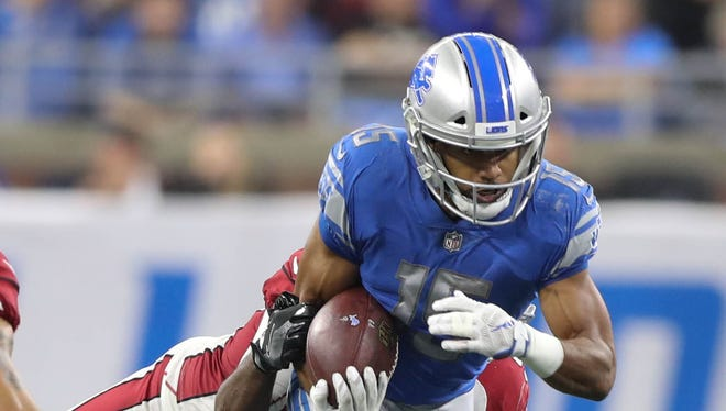 Golden Tate runs for a first down against the Cardinals in the third quarter of the Lions' 35-23 win Sunday, Sept. 10, 2017 at Ford Field.