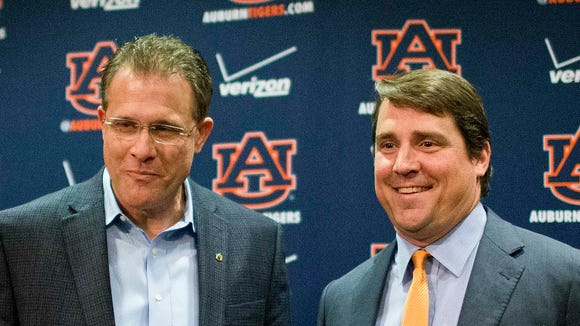 After Auburn coach Gus Malzahn (left) hired defensive