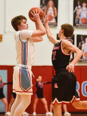 Ridgedale's Preston Burton has the ball against Pleasant's Jason Joehlin in a boys basketball game earlier this year. Area teams found out their tournament schedules after Sunday's Central District draw.