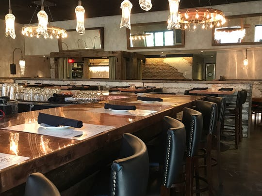 The interior is rustic, yet sophisticated at Burntwood Tavern, now open at Mercato in North Naples.