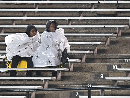 Fans try to keep dry before a game between Vanderbilt