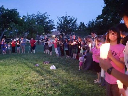 Community members gather at a candlelight vigil Sunday night in the Vernon Worthen Park to mourn the victims of the Orlando nightclub shooting.