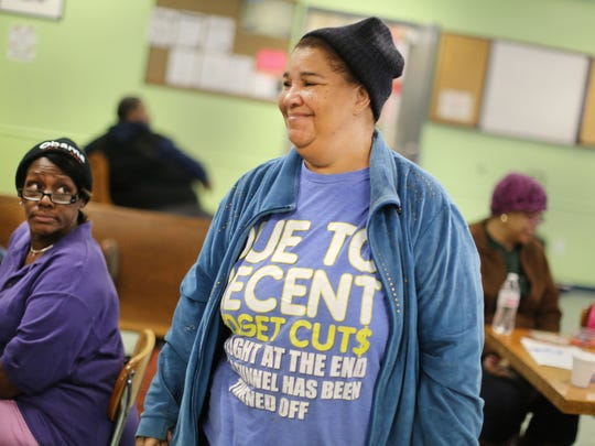 Catherine Jones smiles Tuesday after winning a bingo game at Our Daily Bread in Over-The-Rhine. At left is Tonya Bailey, an OTR resident, who has been playing for about five years.  Our Daily Bread, on Race street across from Findlay Market, has been serving the area since 1985. They serve a full lunch to 400-500 people each day.