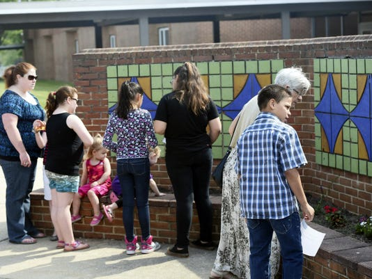 Current students act as tour guides showing tile work that survived a fire at the old school building during Thaddeus Stevens Elementary School's 100th year celebration on Saturday, May 16, 2015. Ryan Blackwell - Public Opinion