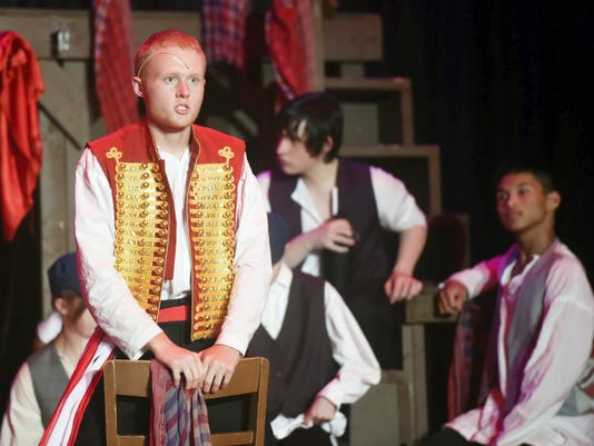 Brian Rutan plays Enjolras during rehearsal Thursday for Les Miserables, a production by Chambersburg middle and high school students. Students have practiced throughout the summer for the musical, which will be performed at 7:30 p.m. July 31 through Aug. 1 in the Chambersburg Area Middle School North auditorium.