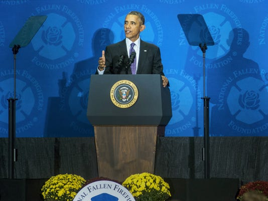 President Barack Obama speaks to the assembled crowd at the National Fallen Firefighters Memorial Serivce on Sunday in Emmitsburg, Md. This marked the president's first year speaking at the service.