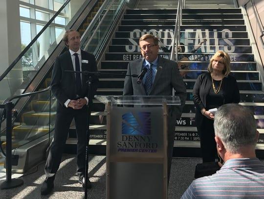 Mayor Mike Huether, with Premier Center's Chris Semrau