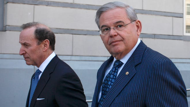 U.S. Sen. Robert Menendez, D-N.J., walks next to attorney Abbe Lowell outside the federal court after he was indicted on corruption charges on April 2, 2015 in Newark.