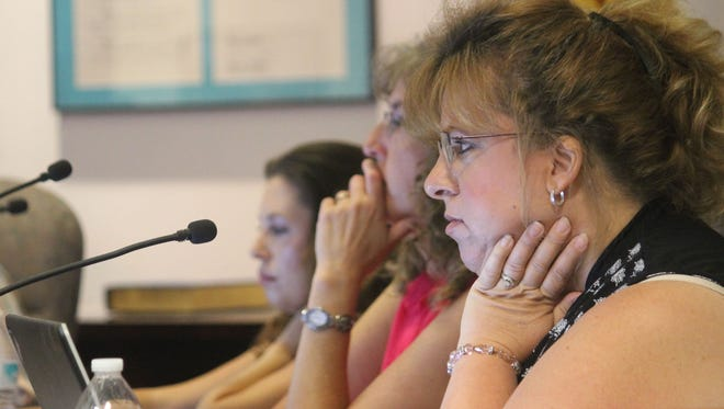 Commissioners Susan Payne, Jenny Turnbull and Erica Martin listen as fellow commissioners discuss the Kids' Kingdom replacement park.
