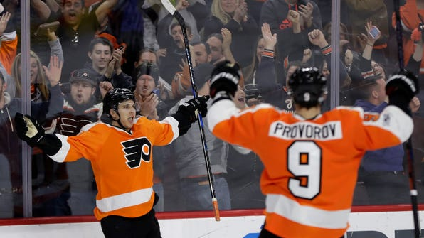 Philadelphia Flyers' Brayden Schenn, left, celebrates with Ivan Provorov after Schenn scored during overtime of an NHL hockey game against the Carolina Hurricanes, Sunday, March 19, 2017, in Philadelphia. Philadelphia won 4-3. (AP Photo/Matt Slocum)