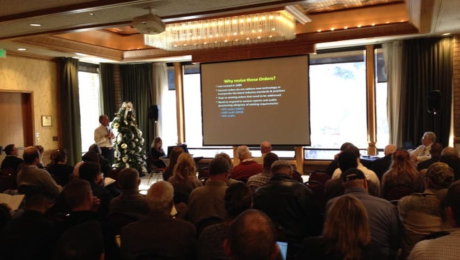 Bureau of Land Management officials on Tuesday discuss proposed updates to rules regulating the oil and gas industry during a meeting at the DoubleTree Hotel in Durango, Colo.