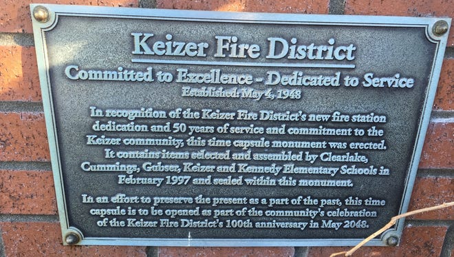 This plaque marks the spot where a time capsule was placed in 1997 in recognition of Keizer Fire District's new fire station on Chemawa Road NE. It is to be opened. It is to be opened in May 2048 in conjunction with the fire district's 100th anniversary.
