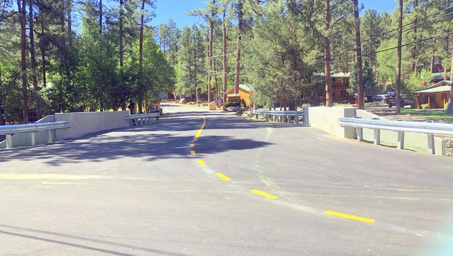 First Bridge reopened Monday, establishng a direct route from midtown Ruidoso to Upper Canyon's lodges and cabins.