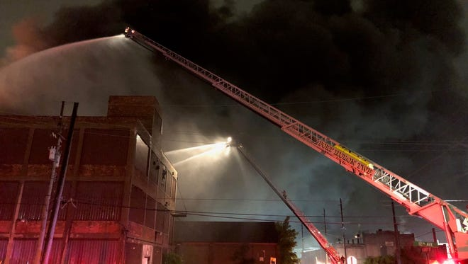 Firefighters battle a blaze at the Chicory Warehouse in Port Huron.