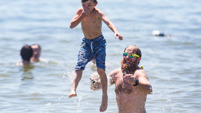 Locals celebrated Ron Bonham Day 2018 with free swimming, fishing, live music, a bass fishing tournament and a fireworks show at Prairie Creek Reservoir Saturday. The annual event honors 38-year superintendent and chief caretaker of Prairie Creek Reservoir, Ron Bonham, a Central graduate who played for the Boston Celtics in the 1960s.