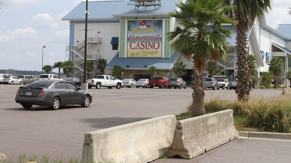 Concrete barricades block all but one of the entrances to Margaritaville Casino in Biloxi after it closed in September. It was the second casino to close in Mississippi this year. Harrah's closed its flagship casino in Tunica in June. (AP Photo/Sun Herald, John Fitzhugh)