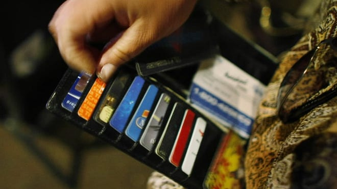 Many Americans struggle with credit card debt.