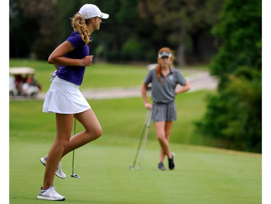 Wylie's Maddi Olson pumps her fist after sinking a