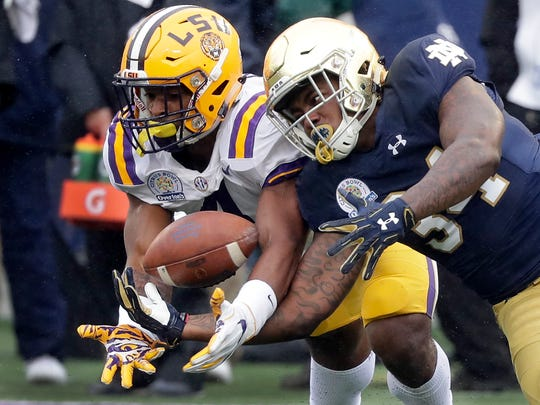LSU linebacker K'Lavon Chaisson, left, breaks up a pass intended for Notre Dame running back Tony Jones Jr. during the first half of the Citrus Bowl  Monday in Orlando, Fla.