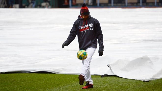 Indians starting pitcher Danny Salazar plays with a soccer ball before the game was canceled.