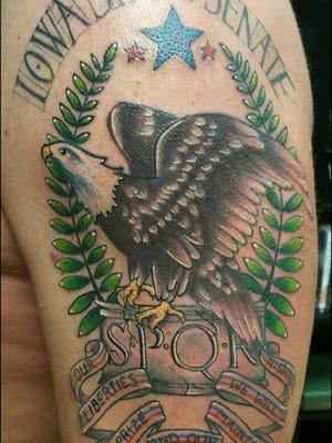 State Sen. Jeff Danielson, D-Cedar Falls, had ink work finished Sunday on an Iowa Senate tatoo on his left arm.