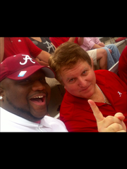 Dr. Michael Nolan Gordon (right), an Olympic High grad, has four season tickets to Alabama football games.
