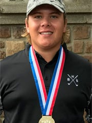 Brownwood's Jaryn Pruitt poses with his gold medal after winning the Class 4A state golf tournament May 23, 2017 at Apple Rock Golf Course at Horshoe Bay in Marble Falls.