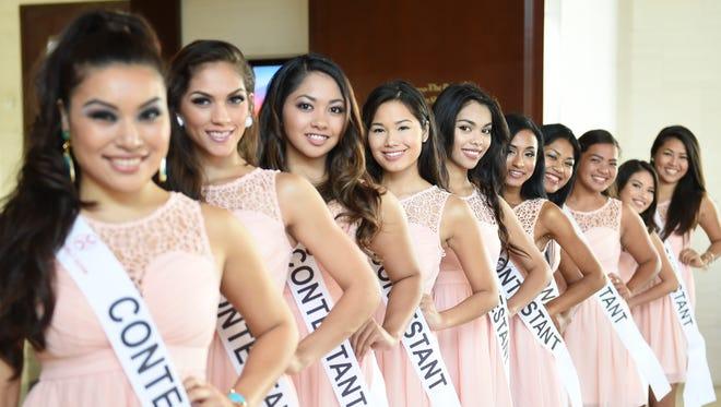 The 2015 Miss World Guam candidates flash a smile at an introductory event at the Sheraton Laguna Guam Resort on Sept. 9. From left are, Jasmine Guerrero, Aria Theisen, Kealexey Pereda, Athena McNinch, Ealani Lobaton, Brittany Wells, Julia Rivera, Mariana Pangelinan, Annaiya Vitkovitsky, and Naomi Quichocho.