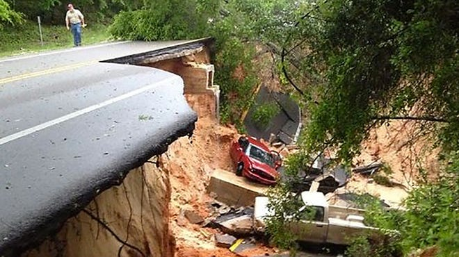 Several vehicles fell about 40 feet after a portion of the Scenic Highway collapsed on April 30 in Pensacola, Fla.
