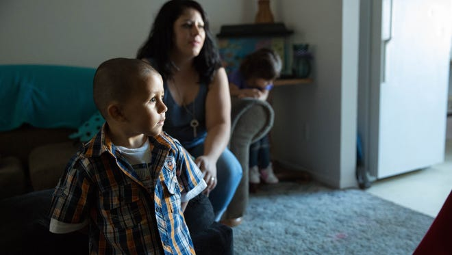 Adrian Pedroza Jr.,2, watches tv with his mom  Adiana Sanchez at the Sanchez/Pedroza home. Friday September 29, 2017.
