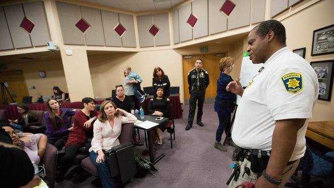 """Mesilla Marshal Kevin """"K.C."""" Alberg speaks with parents during a break out session at the security task force roundtable, Wednesday March 7, 2018."""