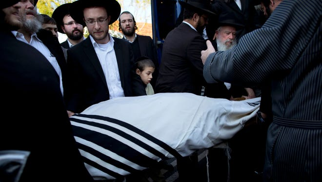 Mourners carry the body of Moshe Twersky during his funeral in Jerusalem.