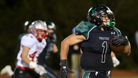 Yorktown's Brett Makar runs with the ball during the