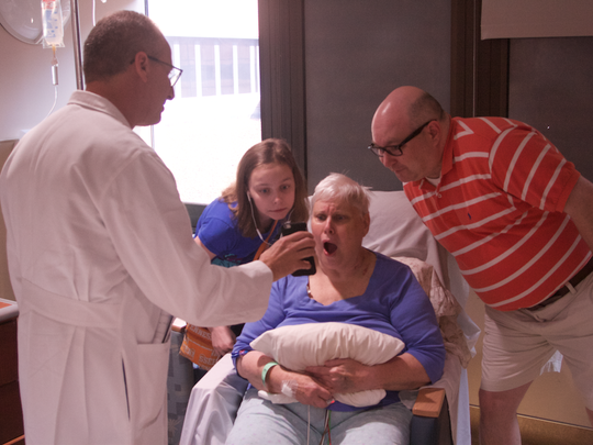 Dr. Rick Miller shows Ruth Root, Maggie Root and Sean Root a picture of the wreckage on Monday, Sept. 5, 2016 at Vanderbilt University Medical Center in Nashville, Tenn.