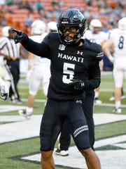 Hawaii wide receiver John Ursua gestures after a first-quarter touchdown during an NCAA college football game against Rice, Saturday, Sept. 8, 2018, in Honolulu. (AP Photo/Marco Garcia)