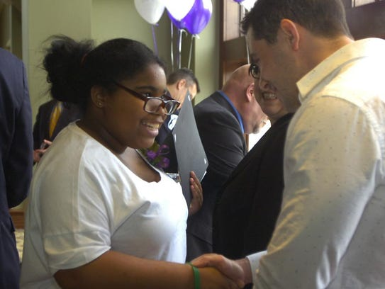 Sienna Jones of Dunckle Middle shakes hands with keynote