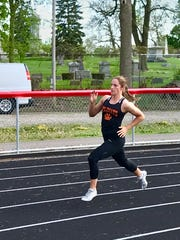 North Union senior Abby Davis runs to a victory in