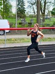 North Union senior Abby Davis runs to a victory in