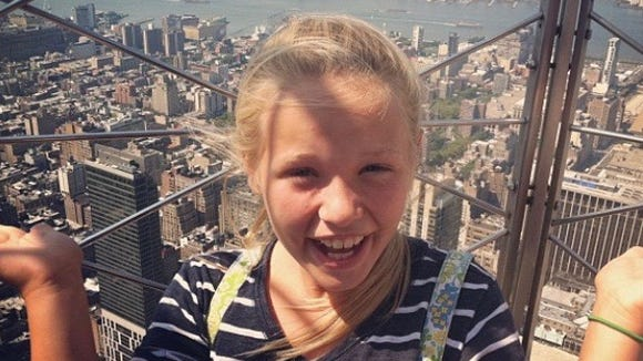 Emily atop the Empire State Building in New York City.