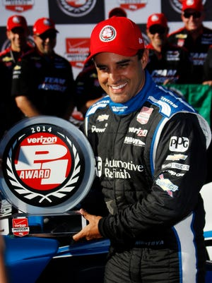 Juan Pablo Montoya poses with the pole award Saturday after qualifying first for Sunday's Pocono IndyCar 500.
