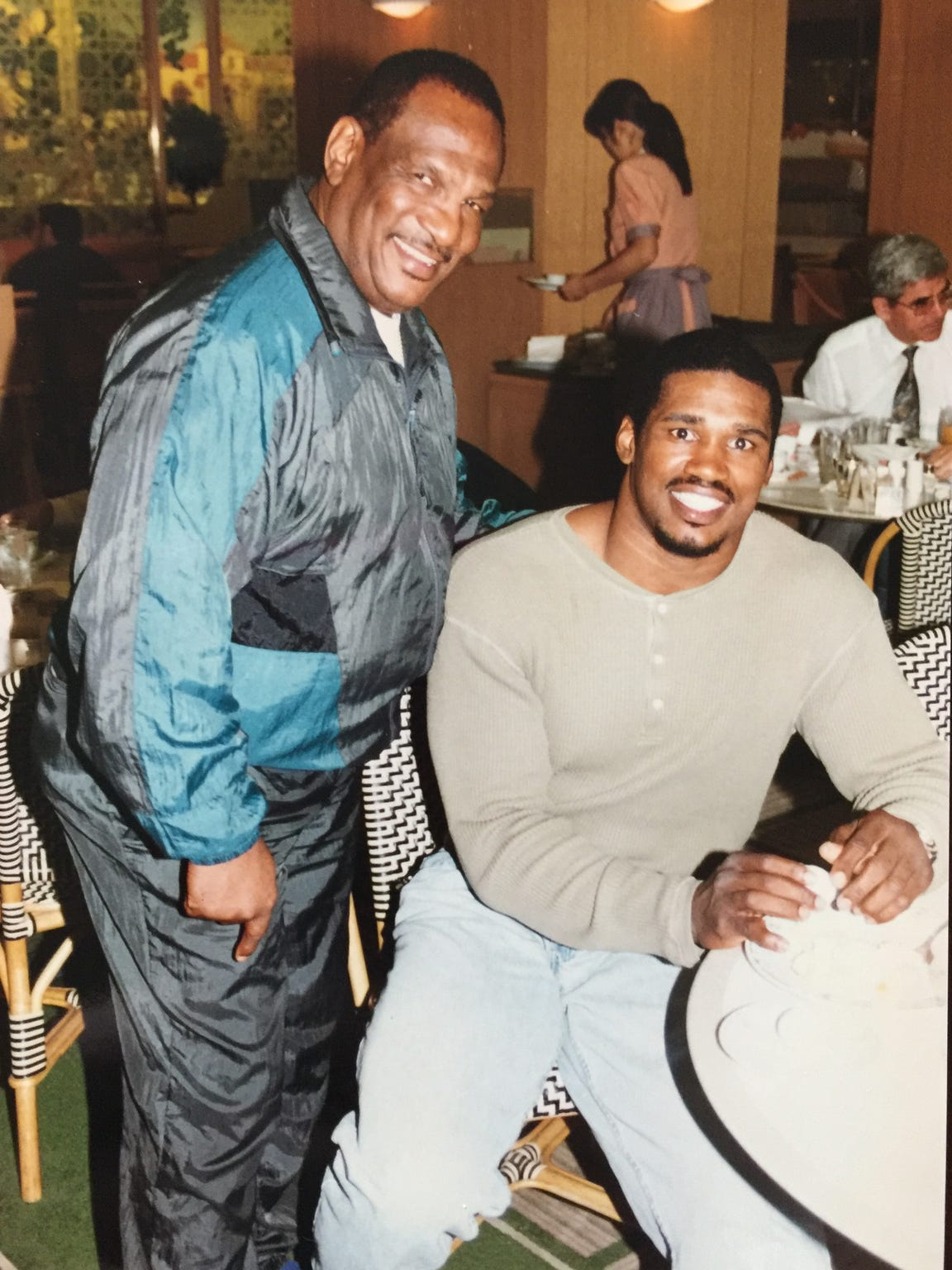 "Alonzo Highsmith and trainer Al ""Potato Pie"" Boulden."